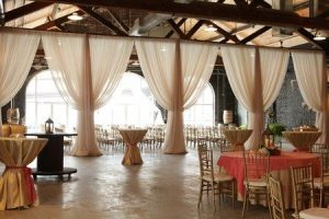 The venue, in this photo, is set up for a wedding reception.