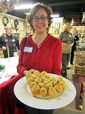 "Angela Pugh offers appetizers at an ""Elegant Dining for the Symphony"" event."