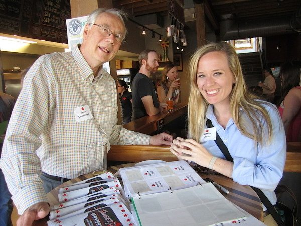 Alan Carmichael and Natalie Lester at the name tag table for the opening of Sweet P's Downtown Dive. (Photo courtesy of the Blue Streak)
