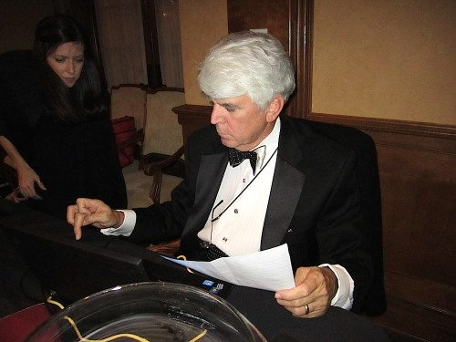 Morton Massey checks out winners after a Symphony Ball auction. (Blue Streak photo)